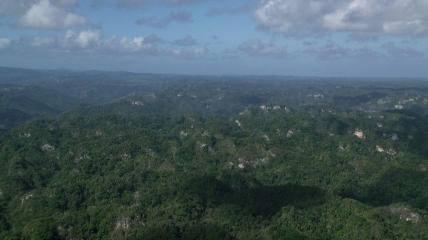 5k stock footage aerial video of Limestone cliffs and lush green jungle, Karst Forest, Puerto Rico  Aerial Stock Footage | AX101_068