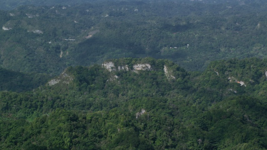 5k stock footage aerial video of Limestone cliffs and lush green forests, Karst Forest, Puerto Rico Aerial Stock Footage | AX101_069