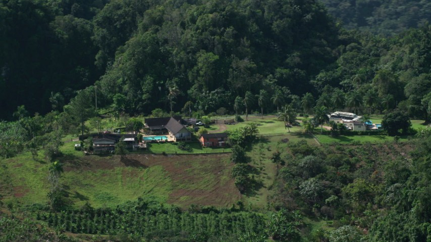 5k stock footage aerial video of an Isolated farmhouse among lush green forests, Karst Forest, Puerto Rico Aerial Stock Footage | AX101_071