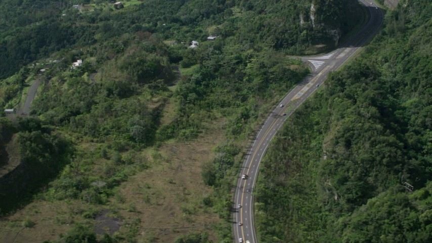 5k stock footage aerial video of a Highway winding through lush green forests, Karst Forest, Puerto Rico Aerial Stock Footage | AX101_073