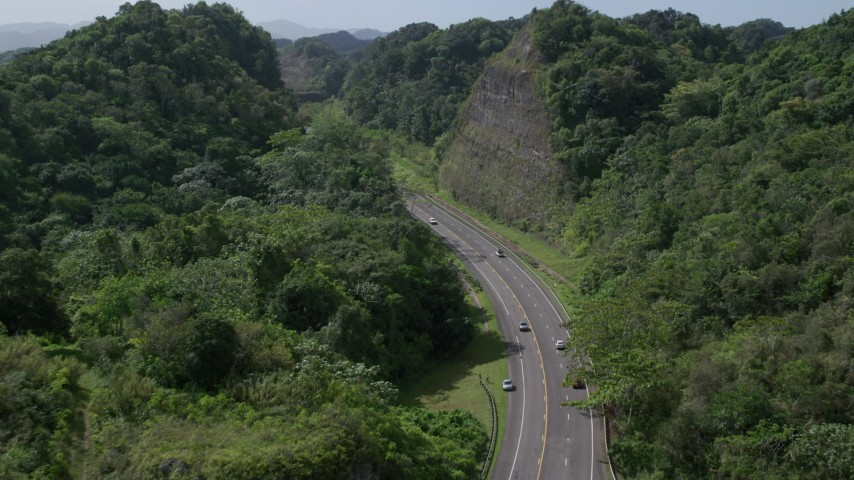 5k stock footage aerial video of a Highway through lush green mountains, Karst Forest, Puerto Rico Aerial Stock Footage | AX101_080