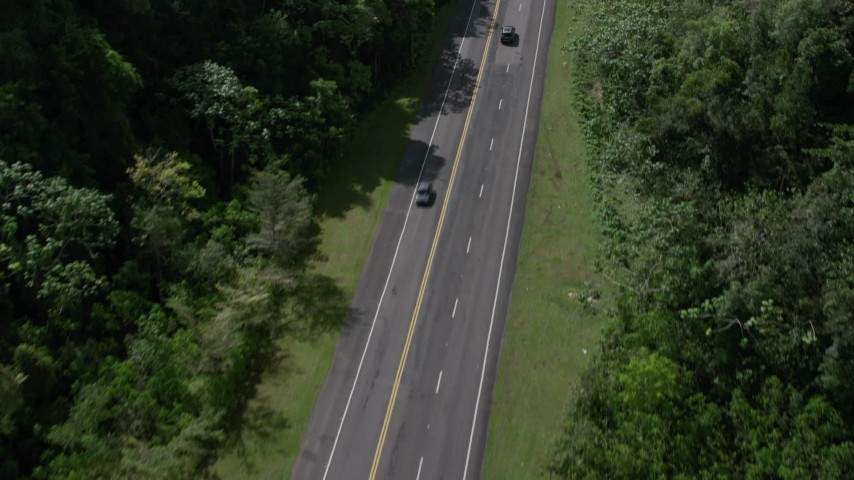 5k aerial video Tilting up on a highway through lush green mountains, Karst Forest, Puerto Rico Aerial Stock Footage | AX101_083