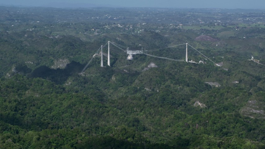 5k stock footage aerial video of Arecibo Observatory nestled among the lush green Karst Forest, Puerto Rico Aerial Stock Footage | AX101_087