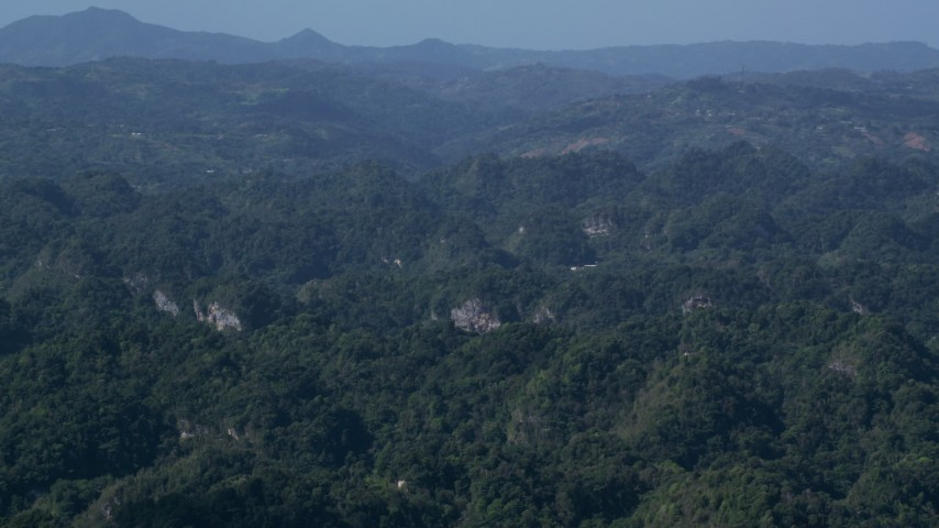 5k stock footage aerial video of Limestone cliffs among lush green Karst Forest, Puerto Rico  Aerial Stock Footage | AX101_088