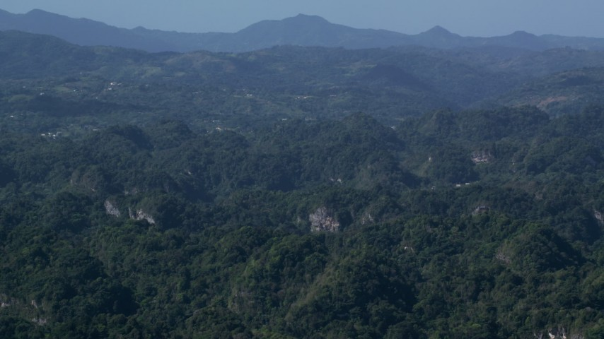 5k stock footage aerial video Flying over lush green forests and limestone cliffs, Karst Forest, Puerto Rico Aerial Stock Footage | AX101_089