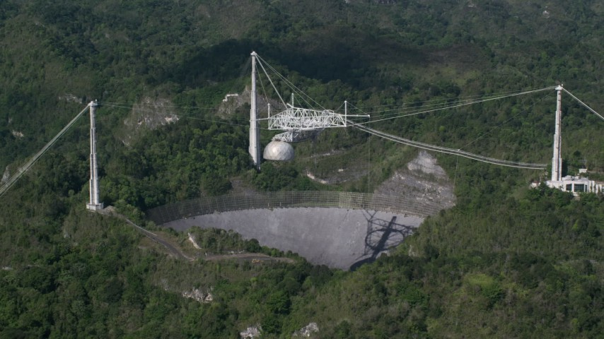 5k stock footage aerial video revealing Arecibo Observatory among lush green forests, Puerto Rico  Aerial Stock Footage | AX101_090