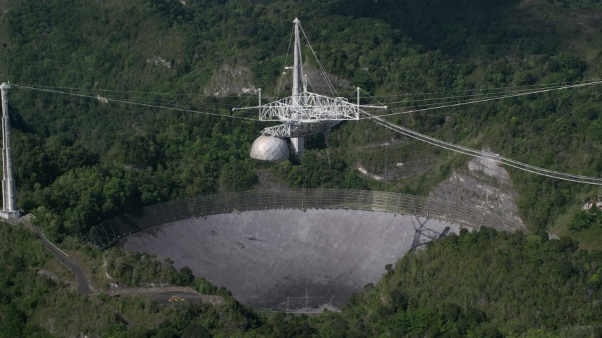 5k stock footage aerial video of Arecibo Observatory in the lush green Karst forest, Puerto Rico Aerial Stock Footage | AX101_091