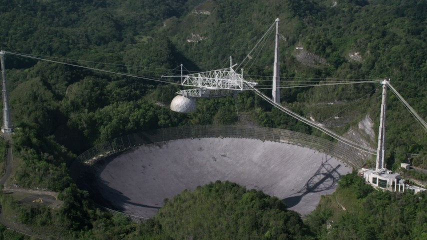 5k stock footage aerial video of the Arecibo Observatory nestled in the lush green forest, Puerto Rico  Aerial Stock Footage | AX101_092