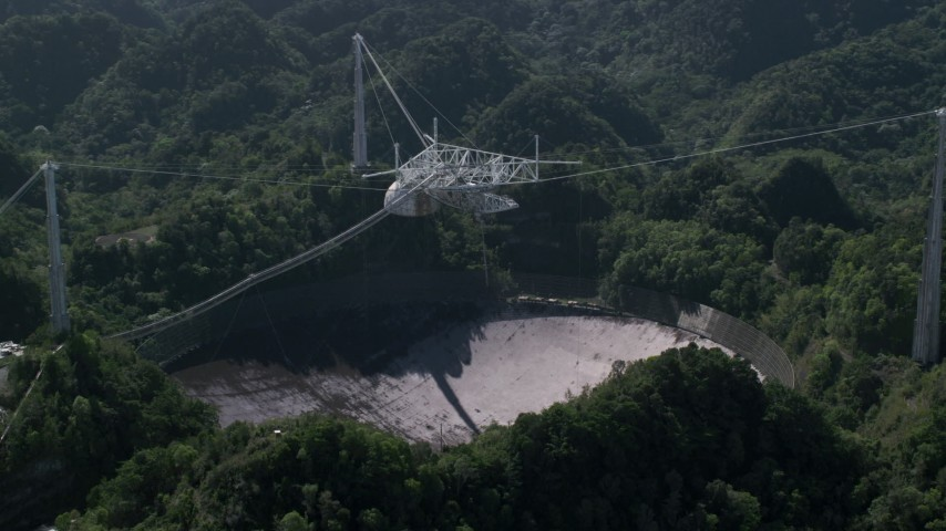 5k stock footage aerial video of Arecibo Observatory nestled in Karst forest, Puerto Rico Aerial Stock Footage | AX101_094