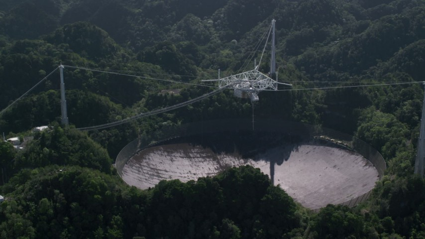 5k aerial video of Arecibo Observatory nestled among Karst forest, Puerto Rico Aerial Stock Footage | AX101_095