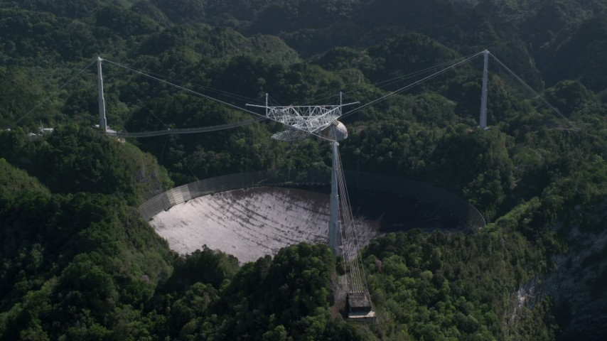 5k stock footage aerial video of Arecibo Observatory surrounded by trees, Puerto Rico  Aerial Stock Footage | AX101_097