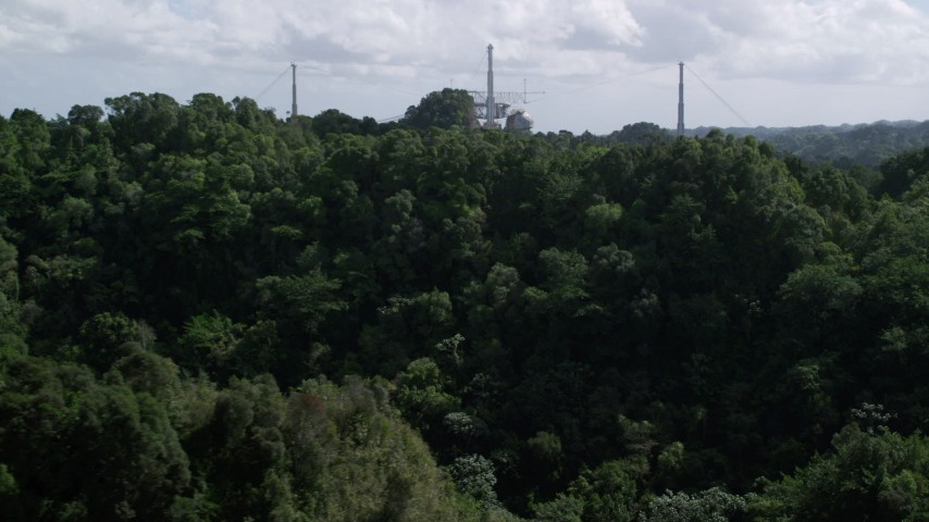 5k stock footage aerial video Descending toward lush jungle from Arecibo Observatory, Puerto Rico Aerial Stock Footage | AX101_109