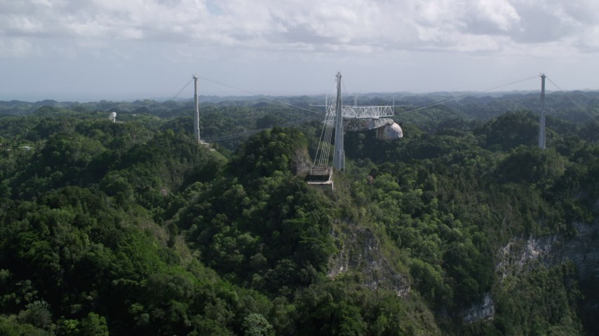 5k aerial video Ascending over lush jungle toward Arecibo Observatory, Puerto Rico Aerial Stock Footage AX101_110