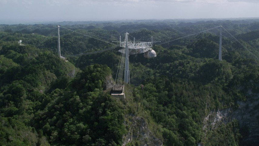 5k stock footage aerial video Tilting down on Arecibo Observatory surrounded by trees, Puerto Rico  Aerial Stock Footage | AX101_111