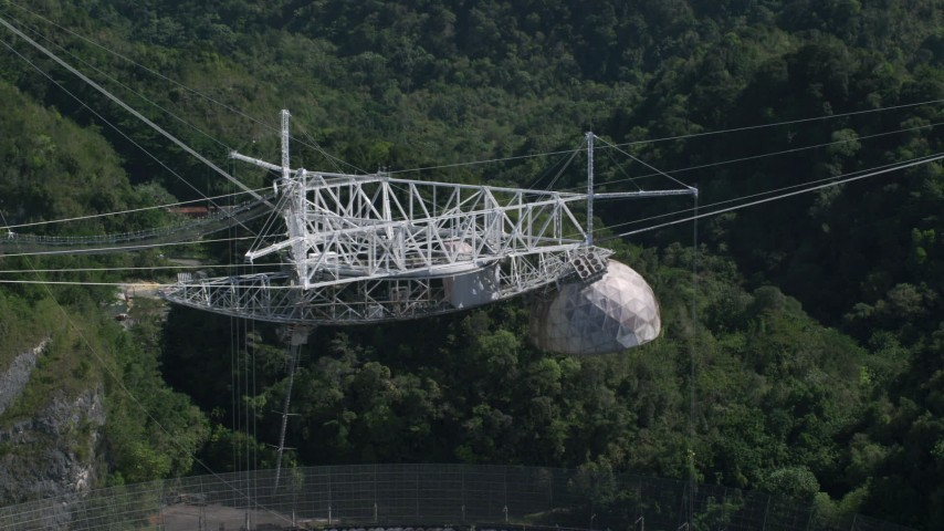 5k stock footage aerial video of Arecibo Observatory from the top with lush green trees below, Puerto Rico  Aerial Stock Footage | AX101_112