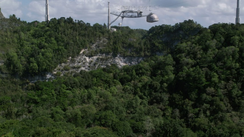 5k stock footage aerial video Low approach above trees toward Arecibo Observatory, Puerto Rico  Aerial Stock Footage | AX101_115