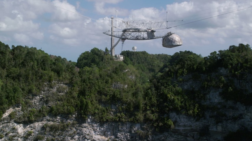 5k stock footage aerial video tilt down on Arecibo Observatory nestled in the trees, Puerto Rico Aerial Stock Footage | AX101_116