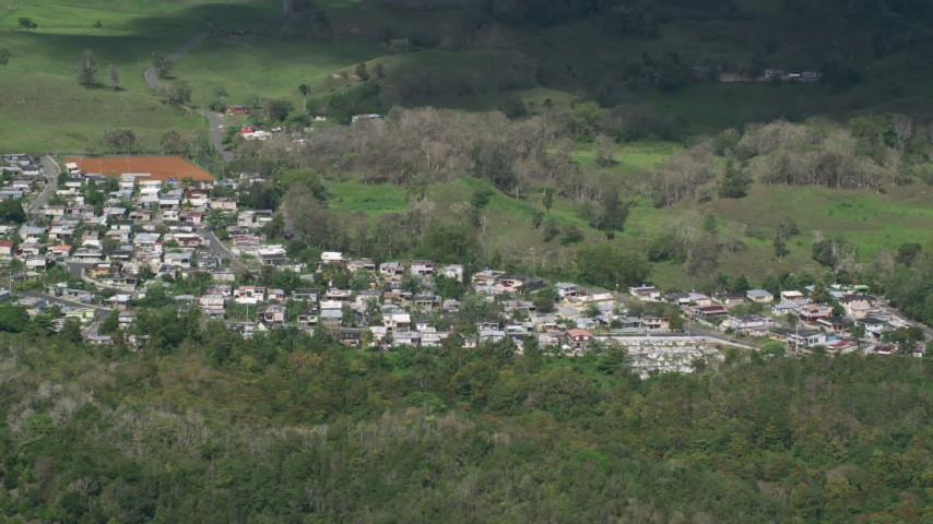 5k stock footage aerial video of a Small rural neighborhood nestled among trees Arecibo, Puerto Rico Aerial Stock Footage AX101_126 | Axiom Images
