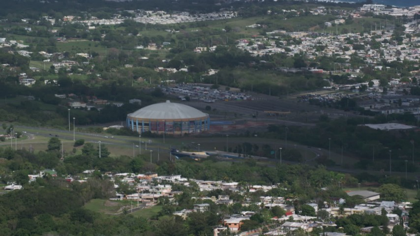 5k stock footage aerial video of the Coliseo Manuel Iguina sporting arena, Arecibo Puerto Rico Aerial Stock Footage | AX101_132