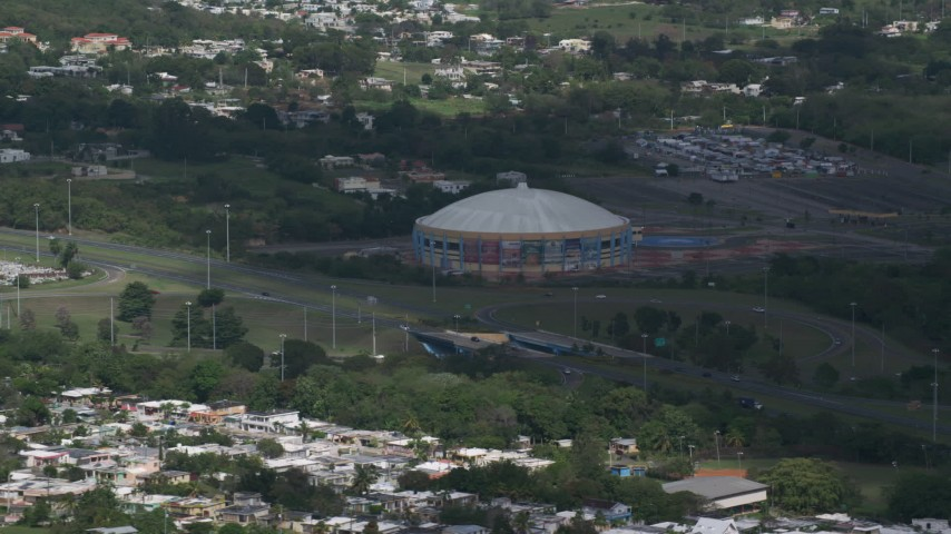 5k stock footage aerial video of the Coliseo Manuel Iguina sporting arean, Arecibo Puerto Rico Aerial Stock Footage | AX101_133