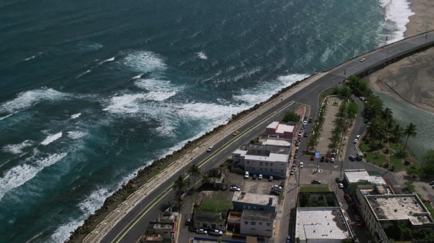5k stock footage aerial video of the Coastal highway, Avenida Victor Rojas, Arecibo, Puerto Rico Aerial Stock Footage | AX101_139