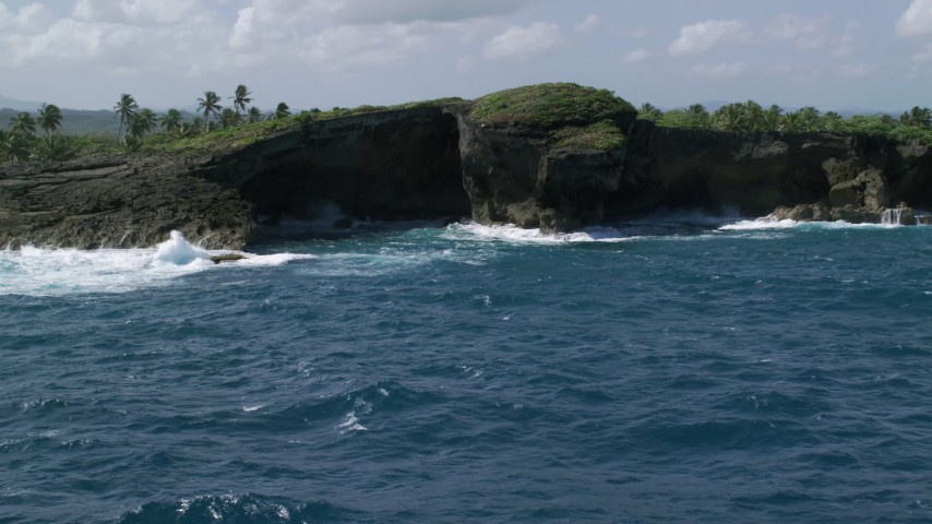 5k stock footage aerial video of Rock formations on the coast of crystal blue water, Arecibo, Puerto Rico  Aerial Stock Footage | AX101_165