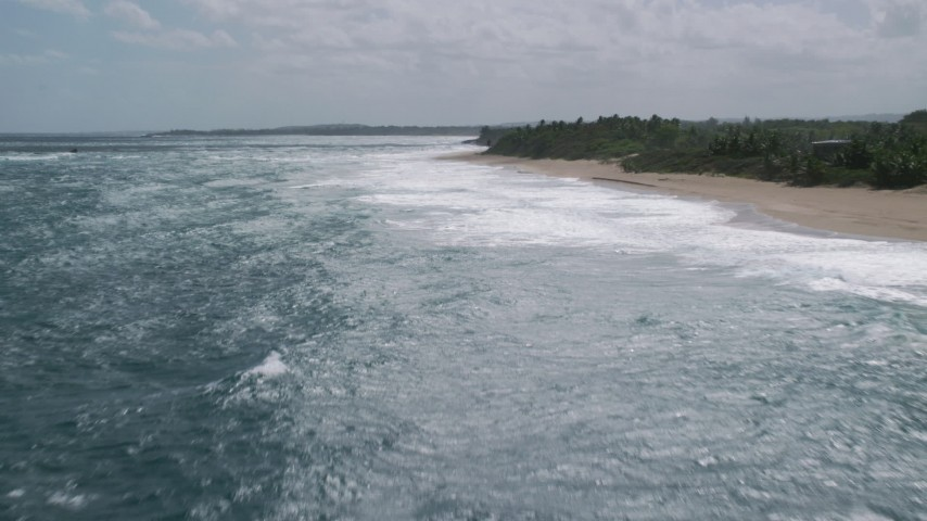 5k stock footage aerial video of Clear blue water along a beach, Arecibo, Puerto Rico  Aerial Stock Footage | AX101_174
