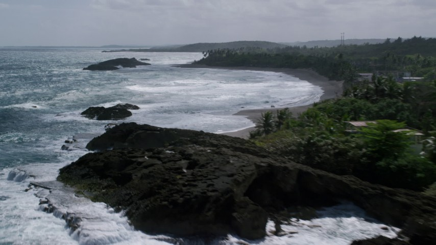 5k stock footage aerial video of Rock formations in clear waters along a tree lined coast, Barceloneta, Puerto Rico  Aerial Stock Footage AX101_181 | Axiom Images