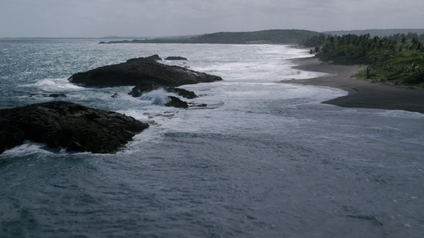 5k stock footage aerial video of Rock formation in clear waters along the coast, Barceloneta, Puerto Rico  Aerial Stock Footage | AX101_182