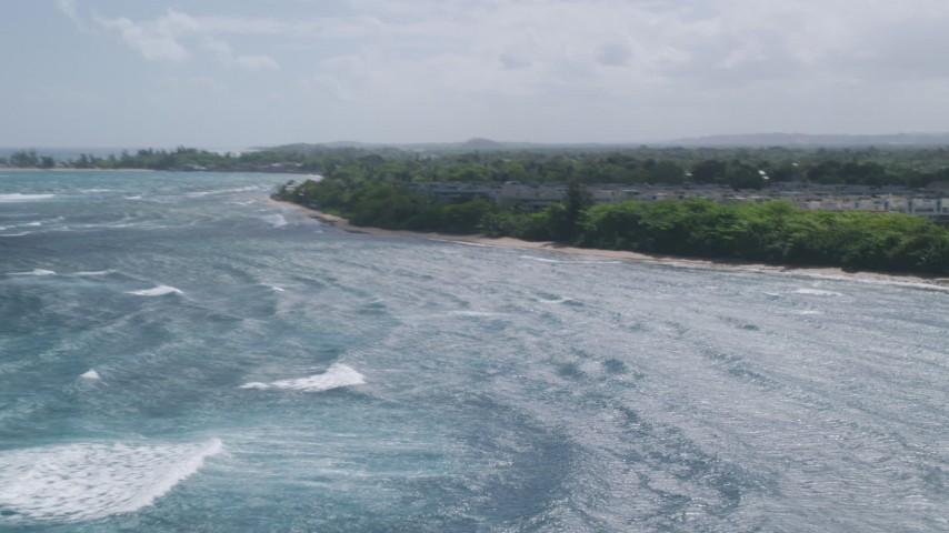 5k stock footage aerial video of Condominiums adjacent to the beach, Vega Baja, Puerto Rico  Aerial Stock Footage | AX101_200