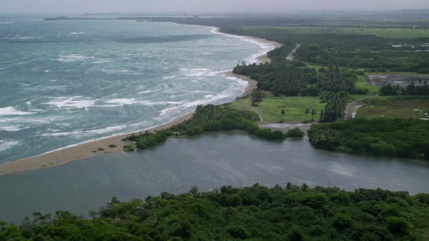 5k stock footage aerial video Following the beach over a lagoon on the coast, Dorado, Puerto Rico  Aerial Stock Footage | AX101_220