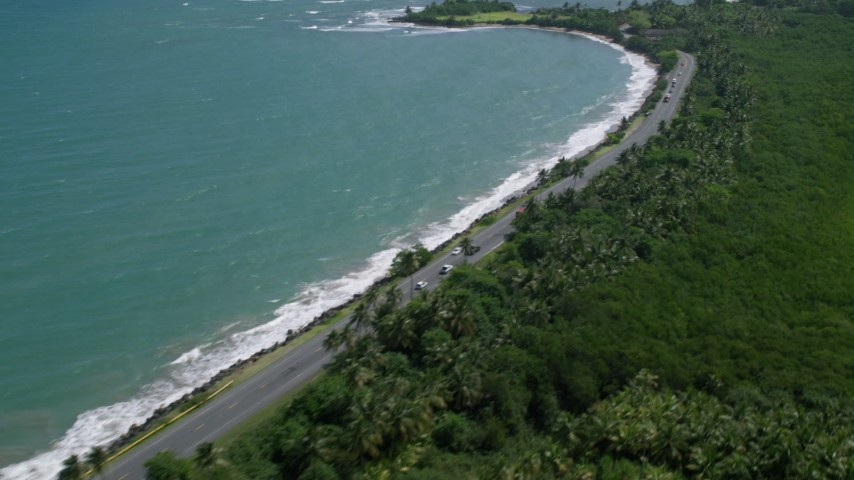 5k stock footage aerial video of a Highway following crystal blue Caribbean, revealing  Punta Salinas Radar Site, Dorado, Puerto Rico Aerial Stock Footage | AX101_227