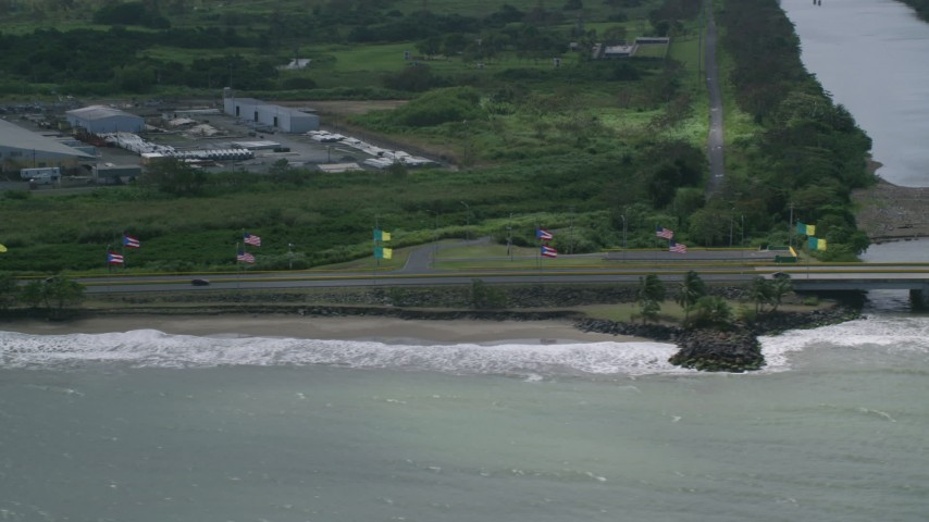 5k stock footage aerial video of Flags displayed along Highway 165, Toa Baja, Puerto Rico Aerial Stock Footage | AX101_231