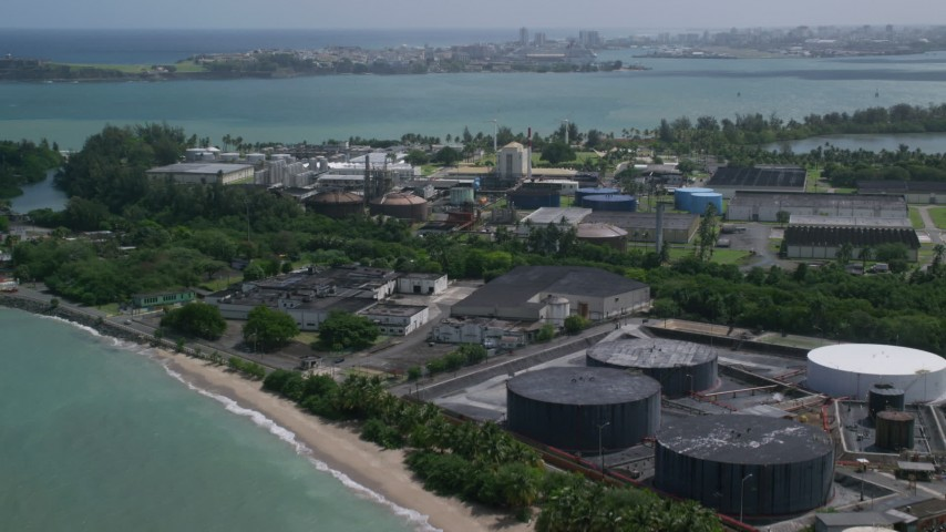 5k stock footage aerial video of a Bacardi Rum Factory along crystal blue waters, Cataño Puerto Rico Aerial Stock Footage AX101_232   Axiom Images