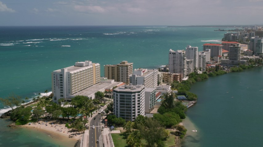 5k stock footage aerial video of Hotels and high rises on the coast and crystal blue water, San Juan, Puerto Rico  Aerial Stock Footage | AX102_002
