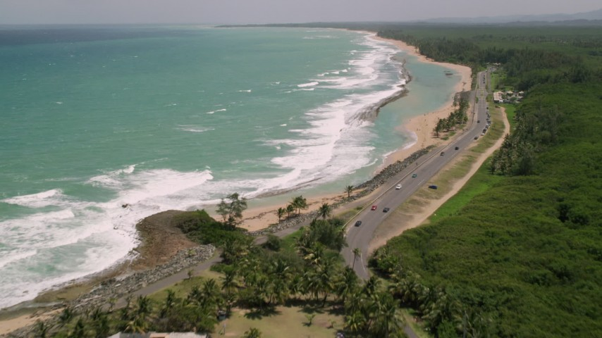 5k stock footage aerial video of Turquoise waters and beach along a highway, Loiza, Puerto Rico Aerial Stock Footage | AX102_018