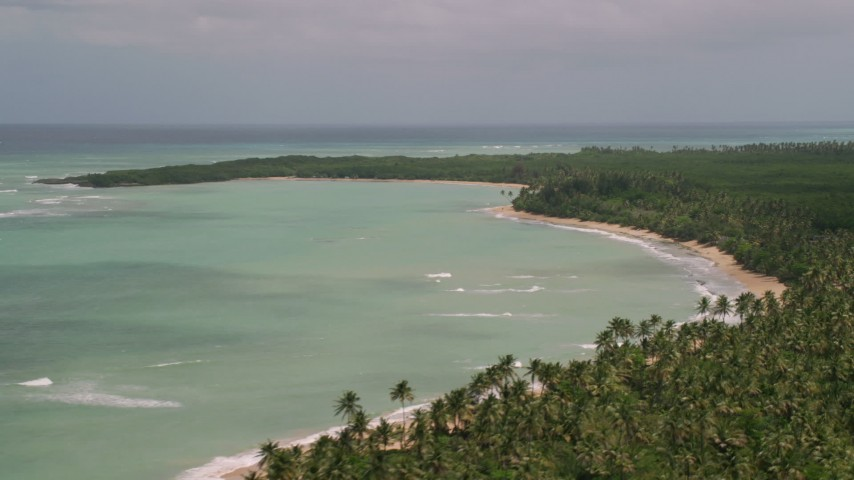 5k stock footage aerial video of a Beach lined by trees and turquoise water, Loiza, Puerto Rico Aerial Stock Footage | AX102_025