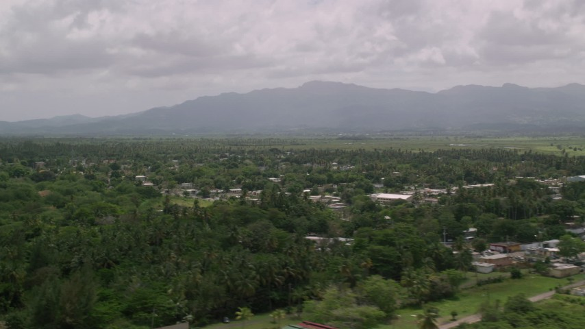 5k stock footage aerial video of Rural neighborhoods nestled in trees near a mountain, Loiza, Puerto Rico Aerial Stock Footage | AX102_031