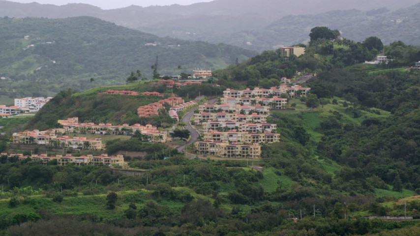 5k stock footage aerial video of Condos on a tree covered hillside, Rio Grande, Puerto Rico  Aerial Stock Footage | AX102_044