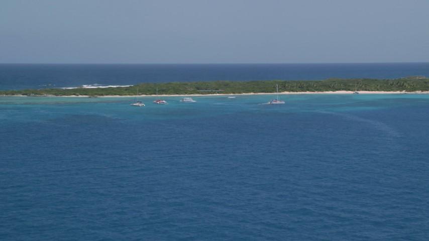 5k stock footage aerial video of Catamarans near an island in tropical blue waters, Rada Fajardo, Puerto Rico Aerial Stock Footage | AX102_073
