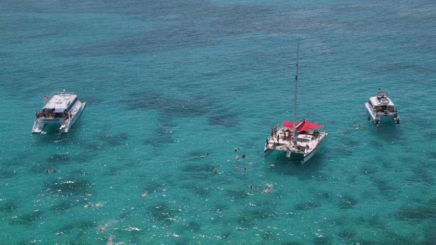 5k stock footage aerial video Flying away from catamarans in tropical blue waters, Rada Fajardo, Puerto Rico Aerial Stock Footage | AX102_078