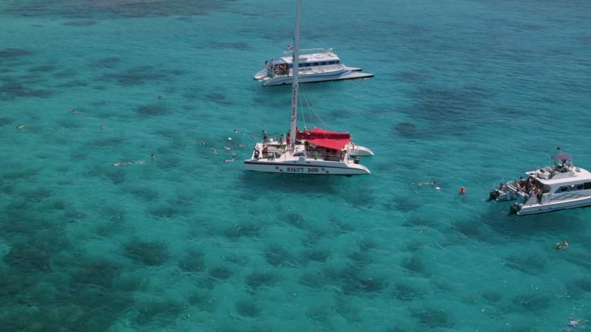 5k stock footage aerial video Orbiting catamarans near a small island in clear blue water, Rada Fajardo, Puerto Rico  Aerial Stock Footage | AX102_079