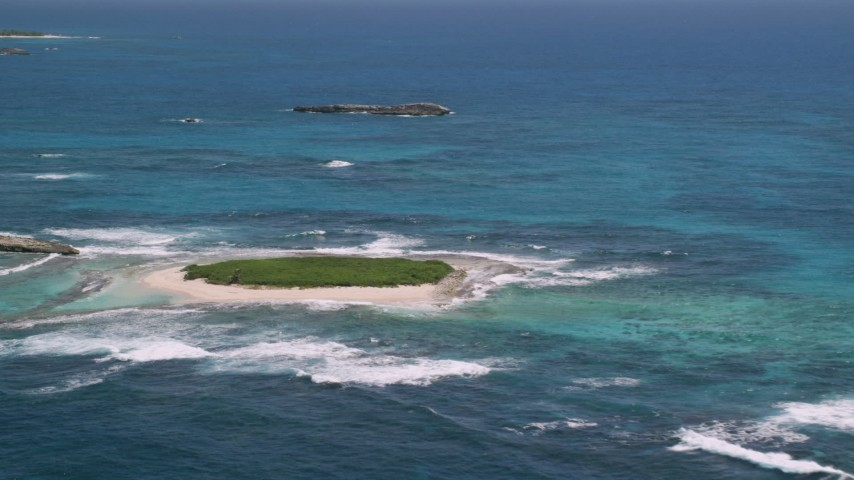 5k stock footage aerial video of Tiny green island in tropical blue waters, Puerto Rico Aerial Stock Footage | AX102_086