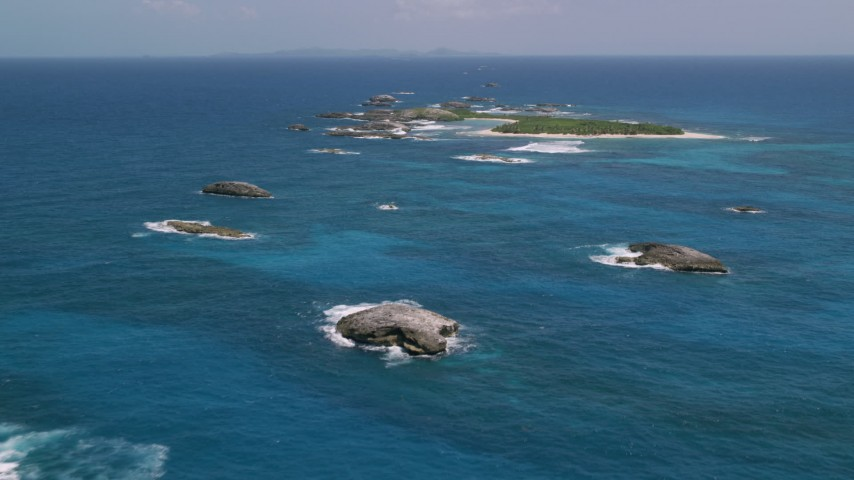 5k stock footage aerial video of a Tiny green island in tropical blue waters, Puerto Rico  Aerial Stock Footage | AX102_088