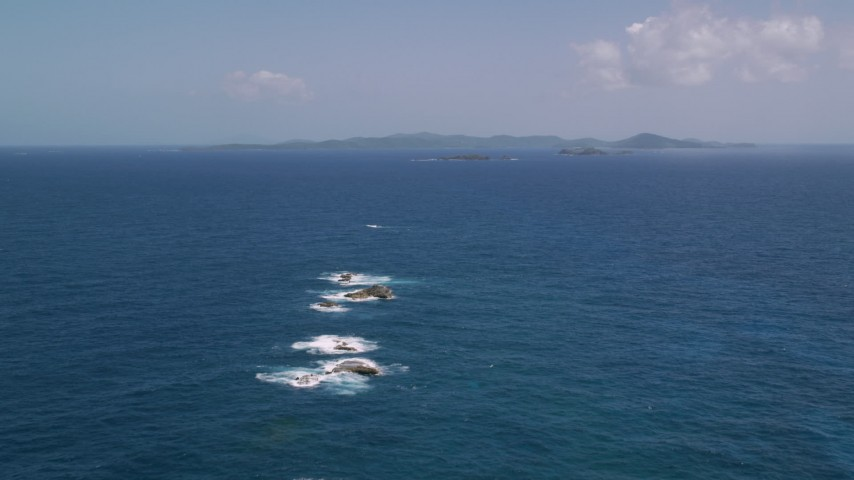 5k aerial video Approaching a larger island in sapphire blue waters, Culebra, Puerto Rico  Aerial Stock Footage | AX102_100
