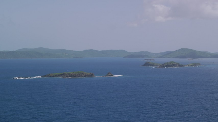 5k aerial video of a Cluster of islands in sapphire blue waters, Culebra, Puerto Rico  Aerial Stock Footage | AX102_101