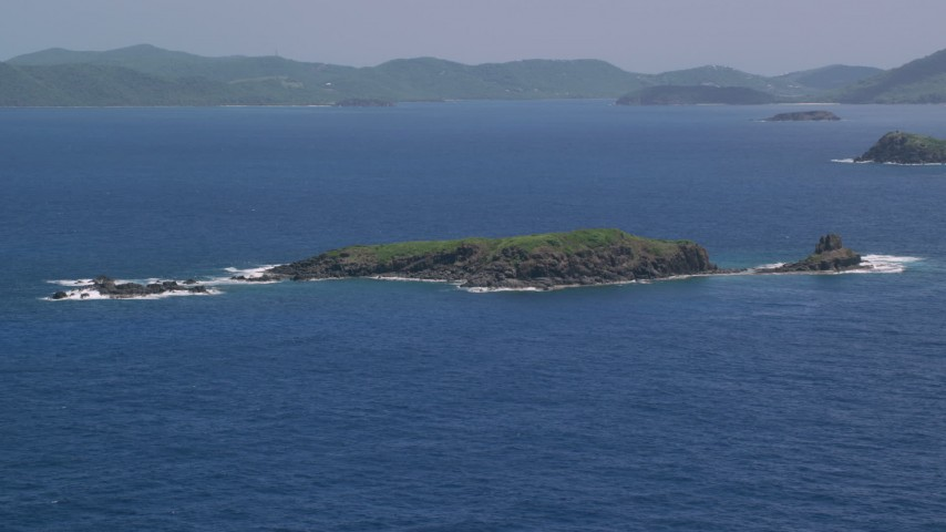 5K stock footage aerial video of a Cluster of islands in sapphire blue waters, Culebra, Puerto Rico  Aerial Stock Footage | AX102_102