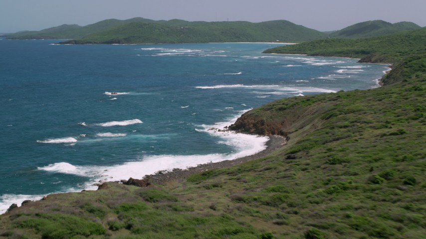 5k stock footage aerial video of Sapphire blue waters along a green island coastline,  Culebra, Puerto Rico  Aerial Stock Footage | AX102_109