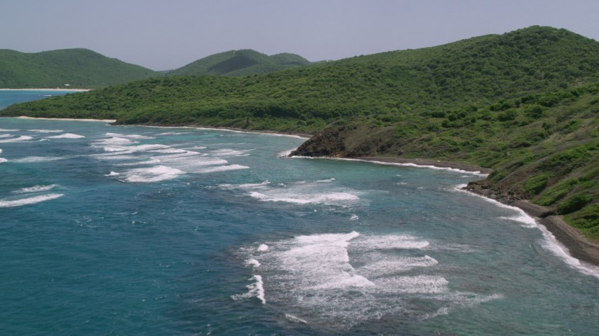 5k stock footage aerial video of Sapphire blue waters and green covered coastline, Culebra, Puerto Rico  Aerial Stock Footage | AX102_110