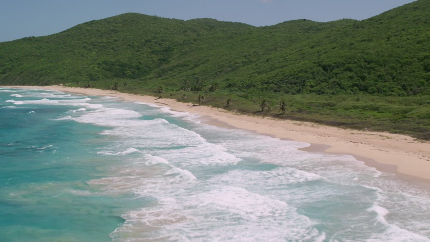 5K stock footage aerial video of Turquoise blue waters along a Caribbean beach and lush vegetative coast, Culebra, Puerto Rico  Aerial Stock Footage | AX102_117